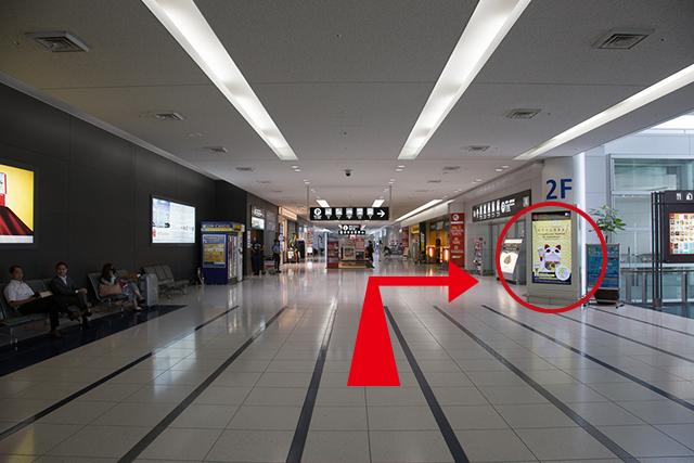 2.Continue straight, go through the passageway visible on your right, and head towards the access plaza.