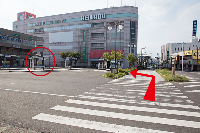 4.After exiting to the ground level, cross the crosswalk, aiming for the #2 Bus Stop. (Circled)